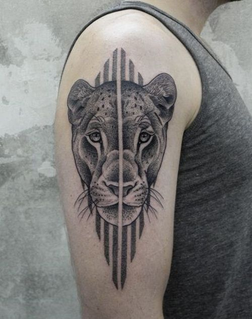 beautiful black and white lioness tattoo in graphic and lineart on the outer arm