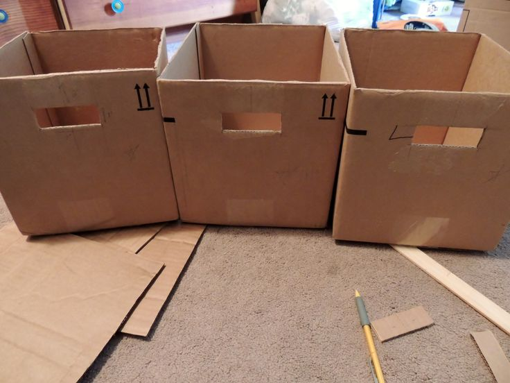 Make your own fabric storage bins out of old boxes