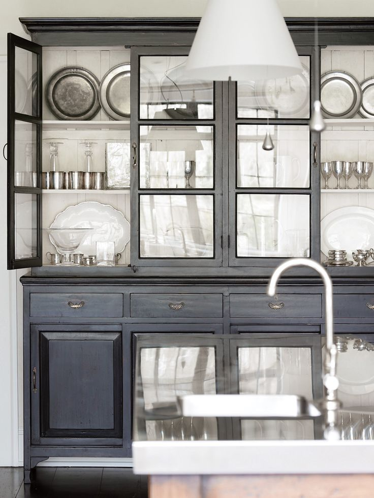 Carter Kay Interiors. Love the charcoal color of this China cabinet...Definitely an idea to paint mine this color. Love the finish.
