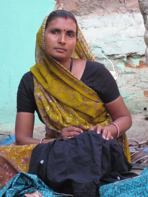 Woman doing embroidery work. Sadhna. Udaipur.