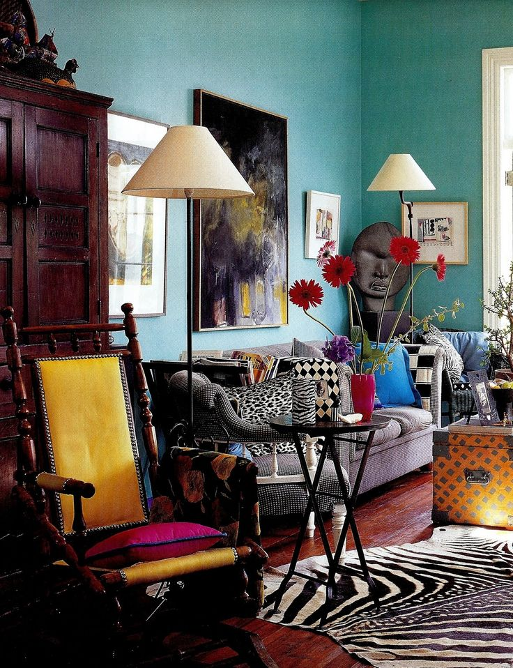 Maybe a bit visually noisy, but great use of shape, color & pattern in this eclectic living room.