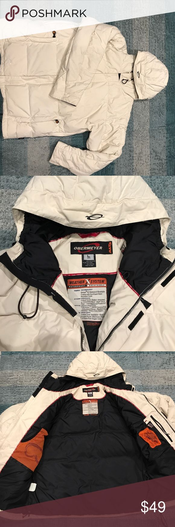 Men's Obermeyer down Ski/Snowboard jacket Down, cream color, large,waterproof, breathable hooded jacket. Has pit zips and several pockets inside and hand pockets on the exterior. Adjustable waist for tightening and Velcro wrist straps/adjusting feature. Obermeyer Jackets & Coats Puffers