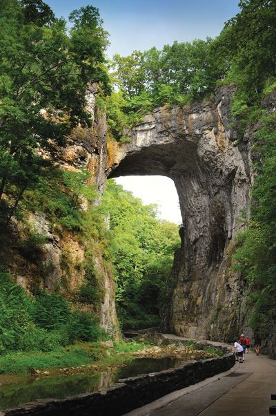 Natural Bridge, VA Has a creation drama that starts at dusk as well as caverns and a hiking trail.