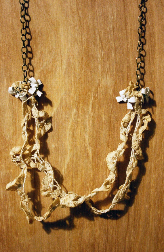 Necklace with vintage ivory crochet trim, white bows and antiqued brass chain
