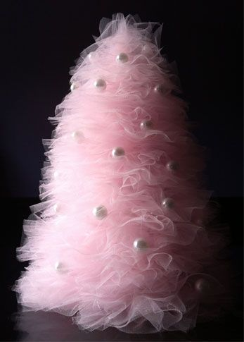 DIY tulle mini-tree with instructions, pictures. Who doesn't love a pink and white tree? This would be cute decor in a nursery!