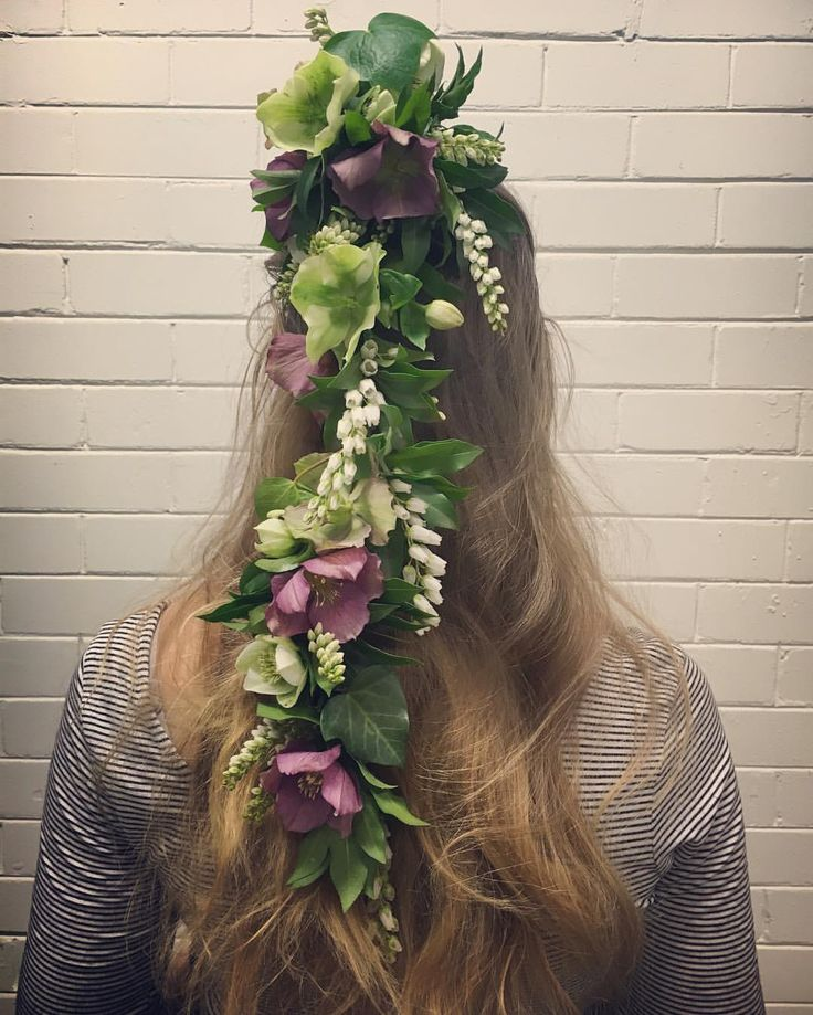 Cascading floral hair piece by Hunting Blooms featuring hellebores and andromeda pieris