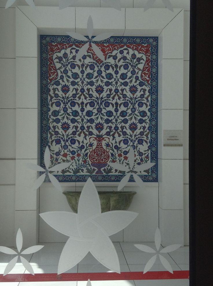 Backsplash of drinking fountain at Sheikh Zayed Grand Mosque in Abu Dhabi, seen through cut glass flowers