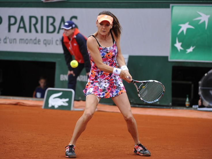 Agnieszka Radwanska delights with a floral dress by #Lotto. #RG14