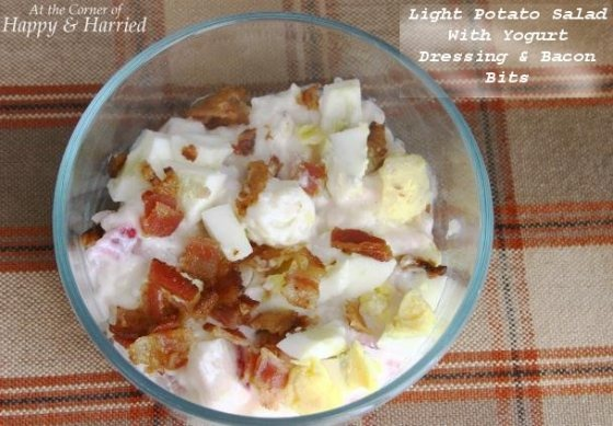 A Light Potato Salad With Creamy Yogurt Dressing.  Garnish with some crispy bacon bits and chopped up boiled eggs, for a delicious side!
