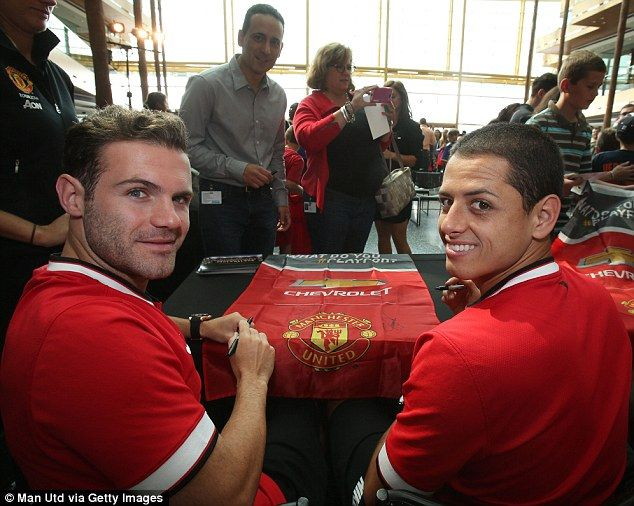 Juan Mata and Javier Hernandez attend a signing session on their latest tour stop
