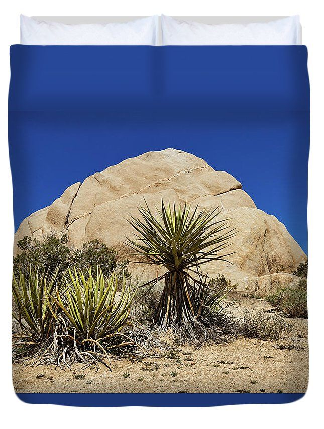 Duvet Cover featuring the photograph Yucca with Rock Formation by Evgeniya Lystsova. Yucca plant with Rock and blue skies in the background, Joshua Tree National Park, California, USA. Wonderful choice for your bedroom (Home Decor, Interior Design). Our soft microfiber duvet covers are hand sewn and include a hidden zipper for easy washing and assembly. Your selected image is printed on the top surface with a soft white surface underneath. All duvet covers a machine washable.