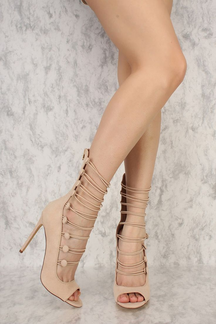 Be sassy in these cuties. The features includes a bold color with a faux suede fabric, elastic strappy straps, back zipper closure, open toe, cushion foot-bed followed by a smooth finish touch. Approximately 4.75 inch heel and 7.5 inch shaft.
