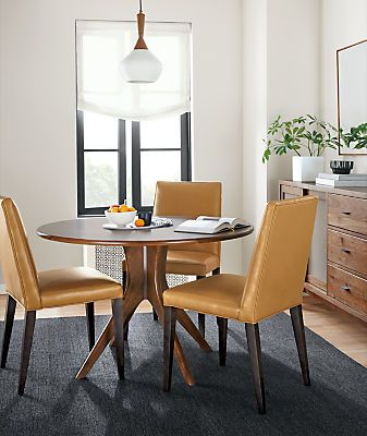 This Mid Century Inspired Dining Table Is Made From Solid Wood And  Highlights The