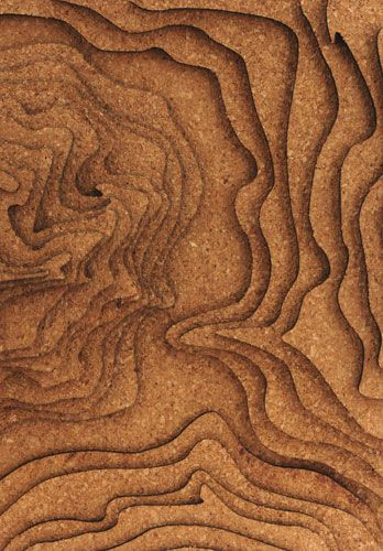 Laser cut cork topographic model. Cork as a material for laser cutting. Hadn't thought of that.