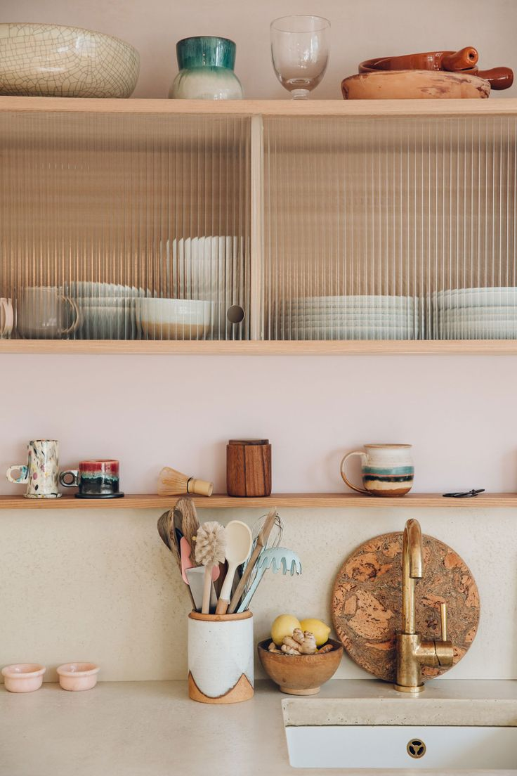 The 42sqm flat in Hackney, London is pretty small: so owners Catherine Verna Bentley & Louis Hagen Hall had to be clever with storage solutions, custom cabinetry and other design ideas.