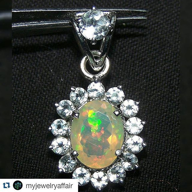 #Repost @myjewelryaffair with @repostapp  Ready to ship....Insane Rainbow Fire Color Play faceted Ethiopian Opal & White Topaz Sterling Silver Cluster Pendant....with Dangling White Topaz Bale  Do you like how this has come up since we started to Custom design and manufacture it ??? Check our previous pictures posted of this pendant in process.... #ethiopianopal #ethiopianopalpendant #opalsilverpendant #opaljewelry #finejewelry #pendant #instaluxe #facetedopalpendant #welo…