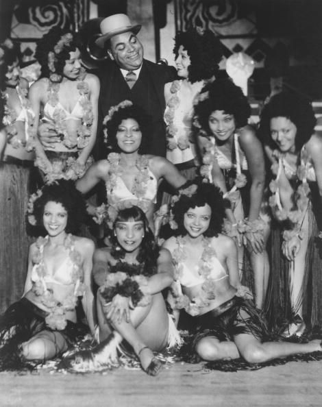 CULVER CITY, CA - CIRCA 1935: Pianist Fats Waller poses with members of the Creole Dancing Revue aka Frank Sebastian's Cotton Club Cuties at Frank Sebastian's New Cotton Club circa 1935 in Culver City, California. (Photo by Michael Ochs Archives/Getty Images)