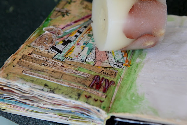 Rub a candle on your finished mixed media project to prevent the page from sticking.