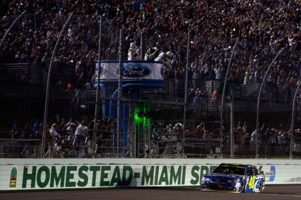 Jimmie Johnson Photos Photos - Jimmie Johnson, driver of the #48 Lowe's Chevrolet, takes the checkered flag to win the NASCAR Sprint Cup Series Ford EcoBoost 400 and the 2016 NASCAR Sprint Cup Series Championship at Homestead-Miami Speedway on November 20, 2016 in Homestead, Florida. - NASCAR Sprint Cup Series Ford EcoBoost 400