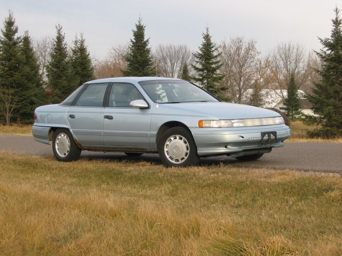 Then my father gave me a 1989 Mercury Sable that he wasn't using.  It was time for me to settle down and raise my three kids.  It did have that cool light thingie running all across the front there!  lol