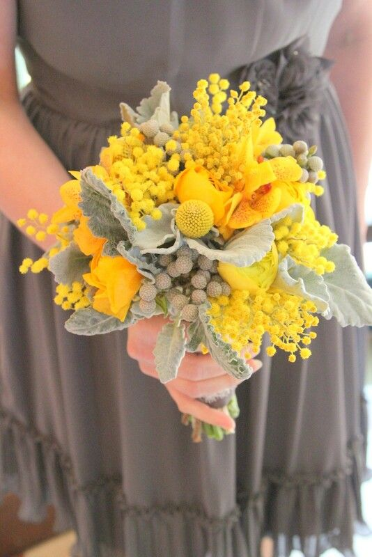 Gorgeous Bridesmaid's Flowers Which Include: Yellow Ranunculus, Yellow Orchids, Yellow Acacia, Yellow Craspedia (Billy Balls), Silver Brunia, & Lovely Leafy Dusty Miller..................