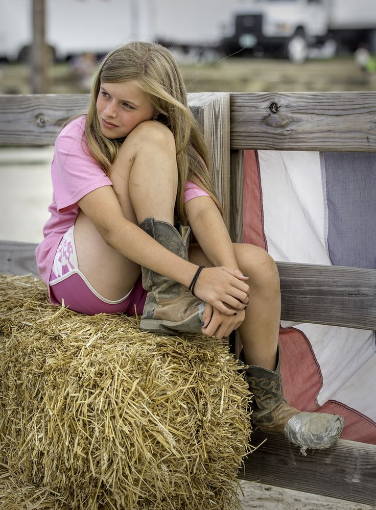 https://flic.kr/p/Y3S82g | Young girl at the corral | I loved that her boots were duct-taped. Taken at the Maryland State Fair.