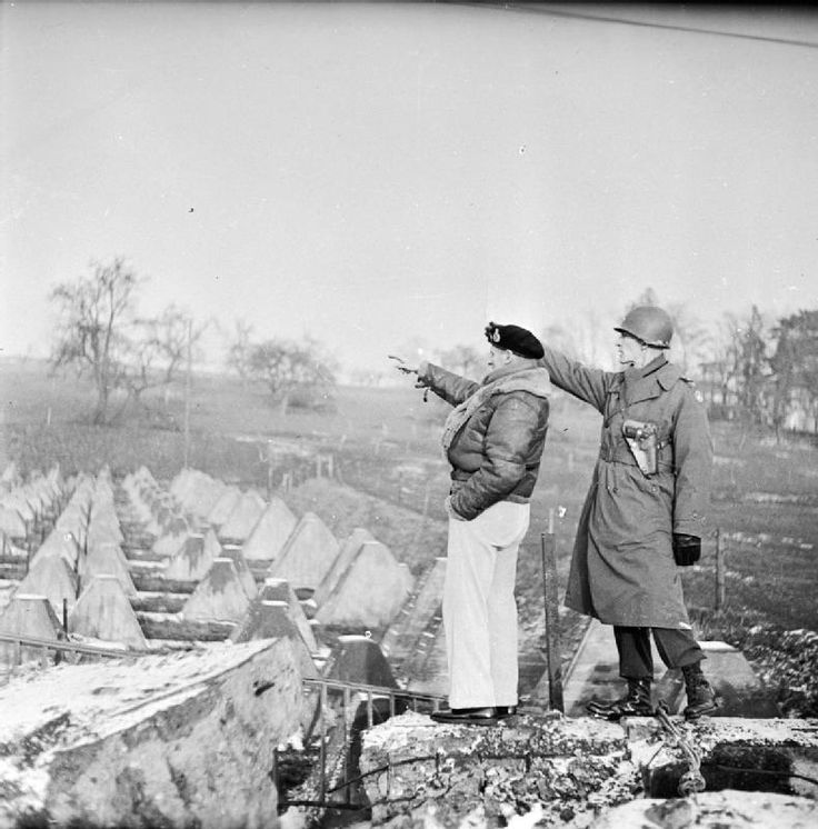 The Second World War 1939 - 1945: Field Marshal Montgomery with Major General Simpson looking at the 'Dragon's Teeth' part of the Siegfried Line. The crossing of the Rhine, which took place during March 1945, was his last major achievement before the end of the war.