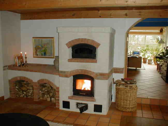A masonry heater is heated with a single fire per day. After a 2 hr fire the heat will warm the house for 24 hours. The upper chamber can, after the fire is out, be used, as a bake oven for bread, meals etc. 87% of the burningvalue of the wood (5,226kwh/kg dry wood minus 0,695kwh/kg water) became heat in the house, and approximately 10% went to the chimney as absolutely nessesary draft. In others words - very close to 100% efficiency, and of course,- very clean burning.