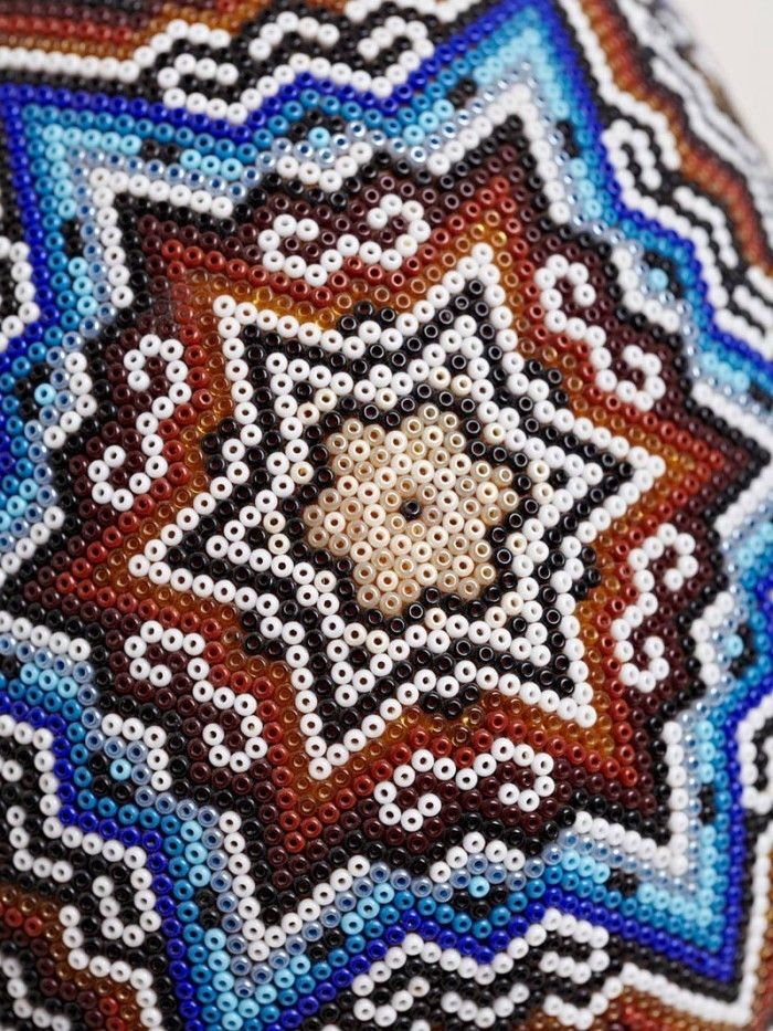 "patternbank: ""'Our Exquisite Corpse' teamed up with the Huichol people of western Mexico to produce these intricately beaded skulls. Each of the heavily beaded pieces has been decorated by various artists from the Huichol, using traditional symbols and designs arranged within the patterns, making every skull a completely unique piece of art."""