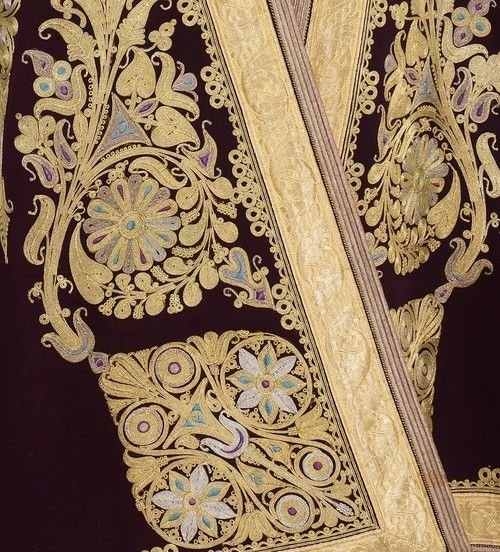 Rich embroidery of gold and solid color insets to resemble gems. Times were good in the early 20th century before the 1929 stock market crash.
