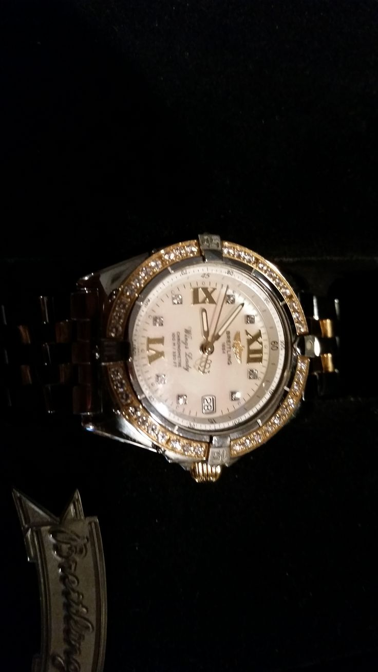 Brightling ladies wings watch (not sure If I got the name right)  @ .5ct diamond yellow gold and stainless. ...for sale.