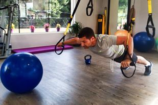 strong men with trx
