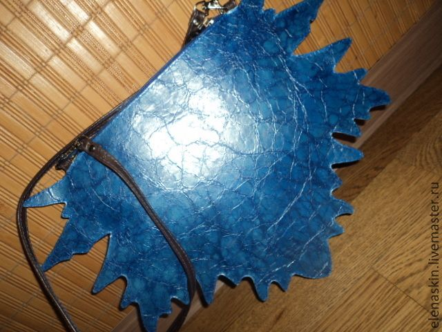 Leather handbag in the form of a maple leaf. The bag fastens with a zipper. It is made of 2 skin tones: classic brown and very beautiful texture the blue. It has elements of embroidery and painting colors. The handle is removable, you can use the bag as a clutch! the inside of the bag 16x20cm, the extreme points of the leaf 25x37cm, handle length 127cm #handmade #genuine #leather #clutch #bag #maple #leaf #blue #brown Ready for sale 28November2015 price 73$USA