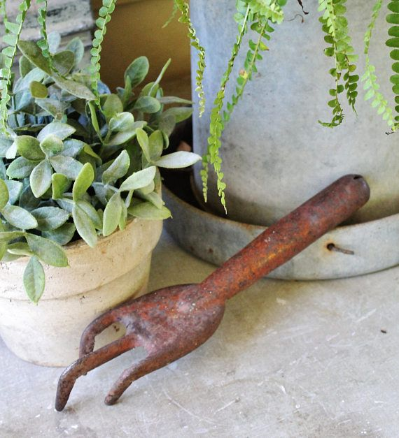 Antique Vintage Gardening Tool Cultivator Measures 12x 2 1/2 Great piece to add to your Farmhouse Décor! This functional gardening tool features a metal end with wooden handle and has it;s original red paint. Great to add to a collection or pair it with the matching hand shovel available in our shop! Please convo us if you have any questions