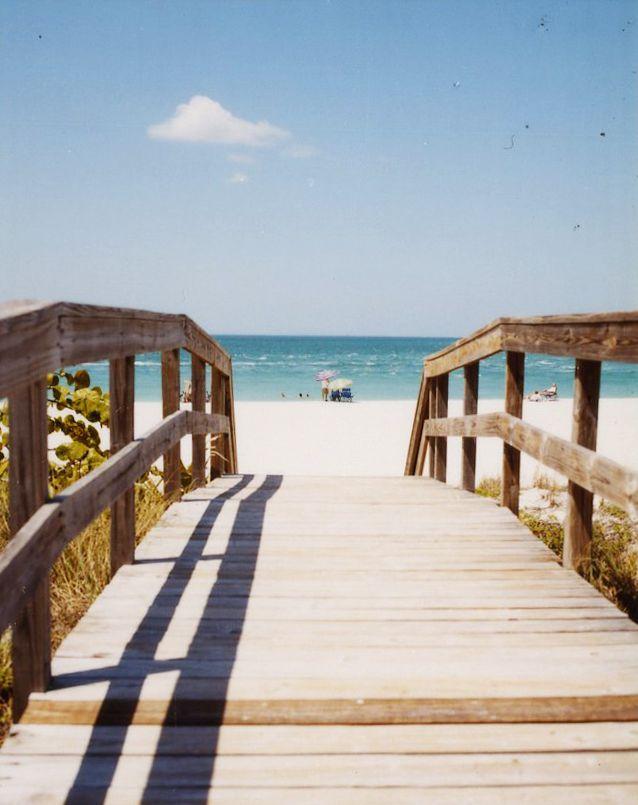 Boca Grande, FL is on our list of best romantic getaways—head to Gasparilla Island National Park for quiet beaches and dockside restaurants. #romance #honeymoon #beach