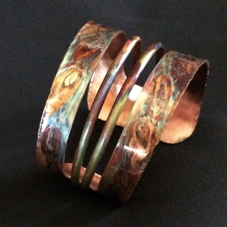 Make A Statement with this Fire Torched Copper Cuff Bracelet. Hand cut from copper sheet, shaped, hammered and then flame painted using an oxy-propane torch to create unique colors and patterns on copper.