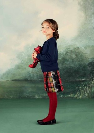 Jacadi navy sweater, plaid skirt, red leggings.