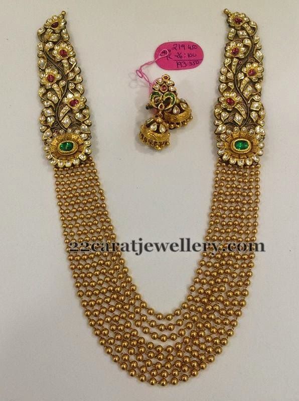 Multiple Strings of gold beads and uncut diamonds, emerald and ruby Haram
