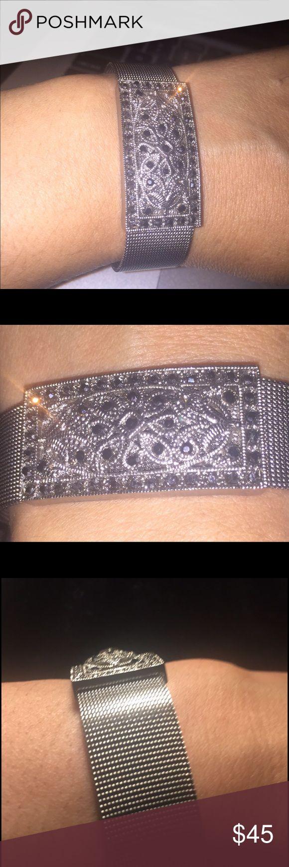 "Vintage Silver Tone Chain Mesh Bracelet Vintage Silver Tone Chain Mesh Bracelet in a Belt Style W /Black Rhinestones Incrustation in a Square  & Flower Metal shapes  ( embroidered alike ) MEASUREMENTS :  Bracelet 's Width  0.80"" & Length 9""  ( Square w/ Black Rhinestones  W .80"" x  D .20"" x  L 1.50"" ) Flaw a little bit of wear & scratch see last picture  Vintage Jewelry Bracelets"