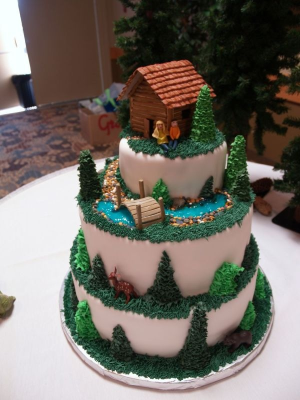 Love this cake for a cabin / Canada themed wedding! I would just change the people of course to match us, maybe add some fish to the river, and instead of dear a big ol momma brown bear and baby bear. Also possible that the bottom layer could be lake themed, with ski boat and dock :)