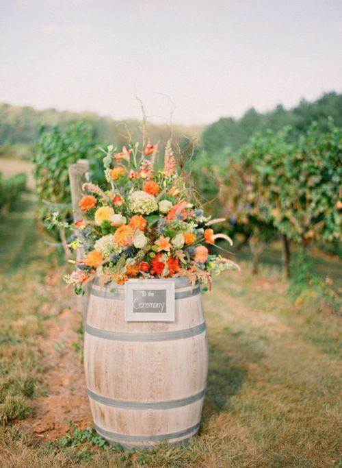 wine barrel floral arrangementWineries Wedding, Orange Wedding, Wine Barrels, Wedding Ideas, Whiskey Barrels, Flower Arrangements, Vintage Rustic, Vineyard Wedding, Floral Arrangements