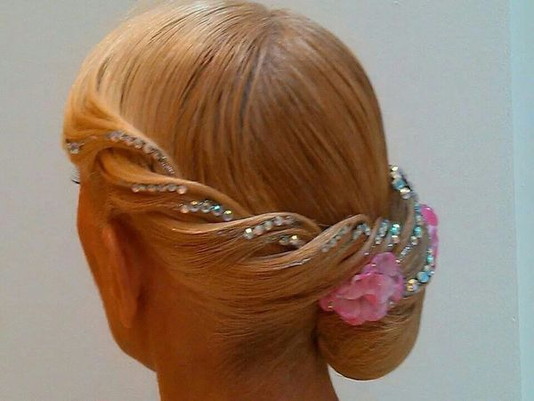 Stunning hairdo for ballroom dance competition.