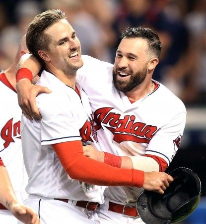 Cleveland Indians Lonnie Chisenhall celebrates with Jason Kipnis after Chisenhall scored the winning run against the Texas Rangers at Progressive Field on June 1, 2016.   Indians won 5-4 in extra innings.  (Chuck Crow/The Plain Dealer)