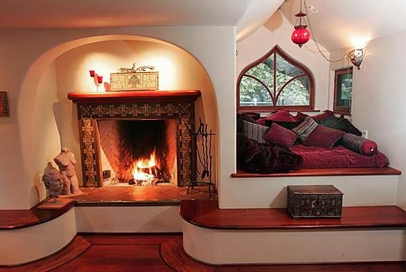 Fireplace and sleeping nook in a cob house. So cool!!