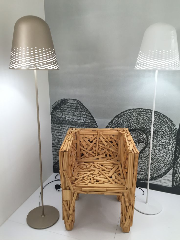 Capri floor lights hanging out with Edra's Favela armchair at Rotaliana