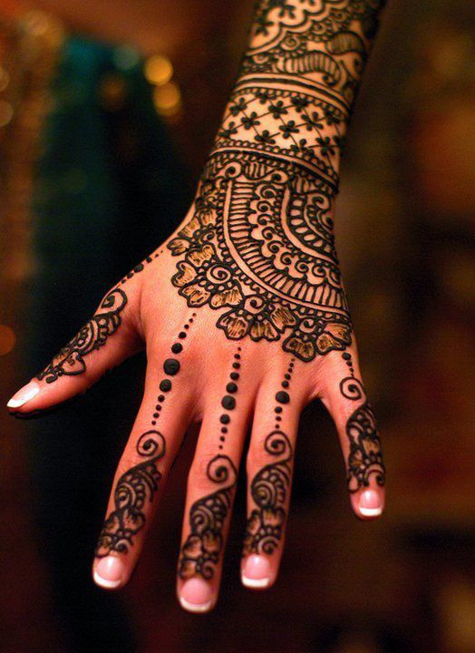 "The Arabic mehndi designs are usually visible on wedding day and ""Henna nights"". Description from randomtalks.snydle.com. I searched for this on bing.com/images"