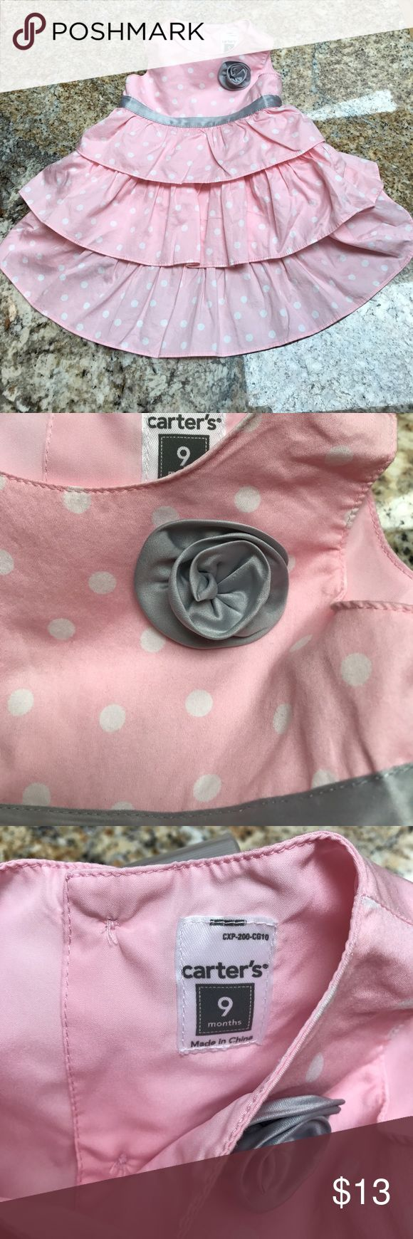 Summer dress Beautiful light pink, white polka dots, with a silver ribbon flower and accent dress. I would consider it in Excellent condition if it wasn't for the one tiny stain on the back (pictured) ✨BUNDLE AND SAVE✨ Carter's Dresses