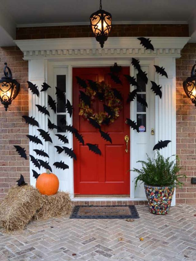 Halloween front porch, with a colony of bats flying across the front door.
