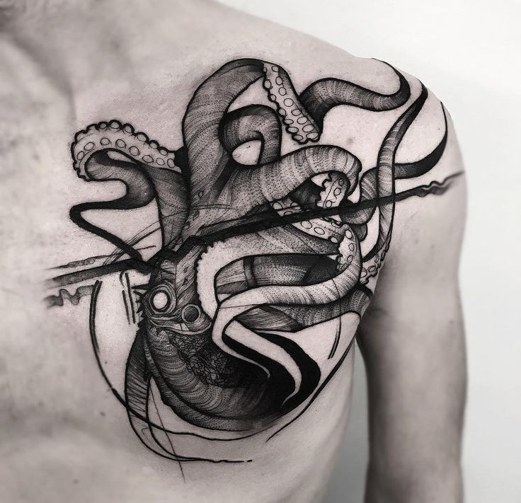 Upside down, black ink octopus on guy's chest with tentacles all over the place.Octopus Chest Tattoo on AZ-DesignIdeas.com