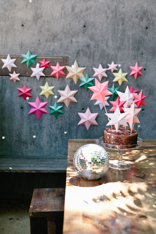 3D bright paper stars -- so easy to make, and this DIY tutorial shows you how to make 3D stars of any size. All you need is colorful paper and some household supplies, and you've got lots of party decor for cheap!